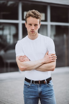 Young man model posing in the street