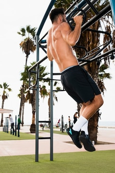 Young man morning routine pullups
