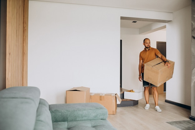 Young man moving into new house