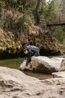 Young man in nature at river