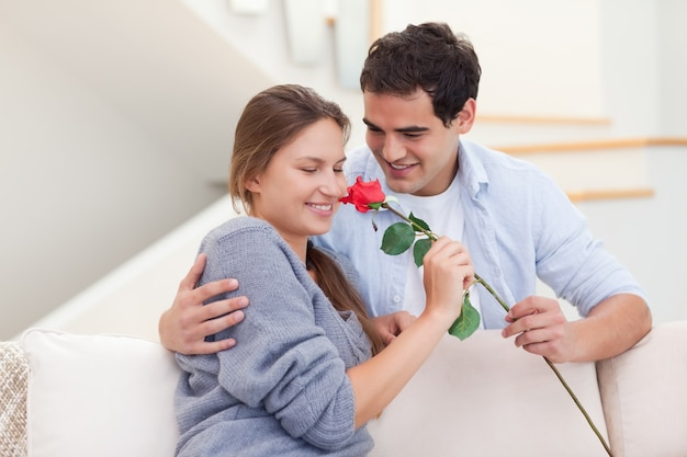 Young man offering a rose to his fiance