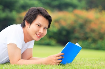 Young man open a book