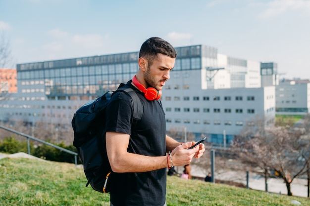 Young man outdoor using smart phone