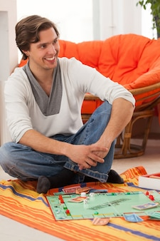 Young man playing a game at home