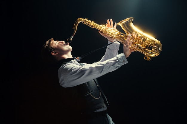 Young man playing a saxophone