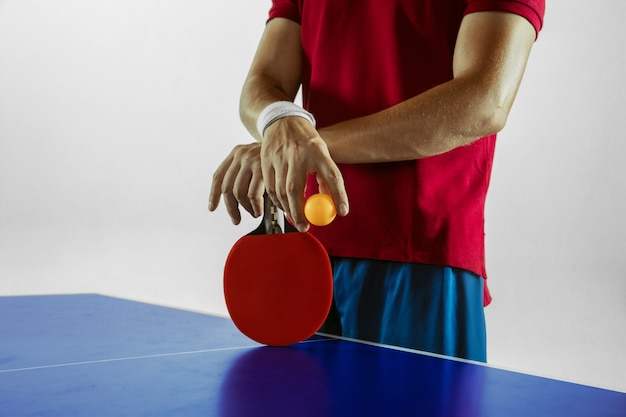 Young man playing table tennis