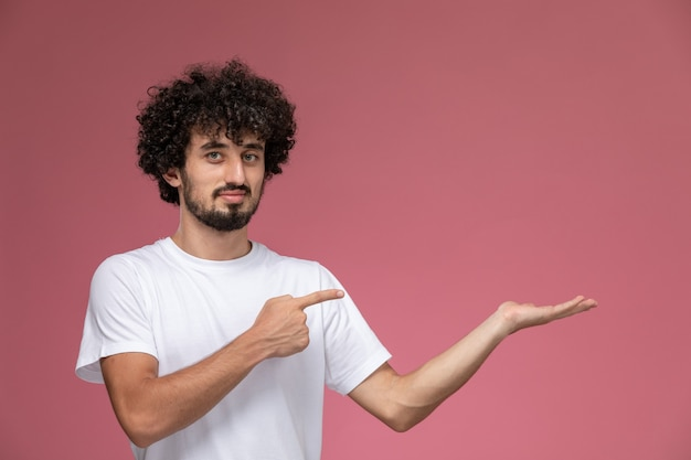 Young man pointing out his empty hand