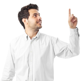 Young man pointing up on a white background