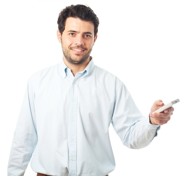 Young man pointing with a remote control on a white background