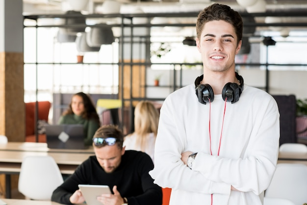 Young man posing in office