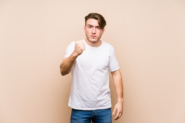 Young man posing showing fist
