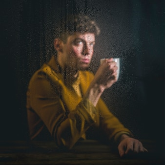 Young man posing with cup of coffee