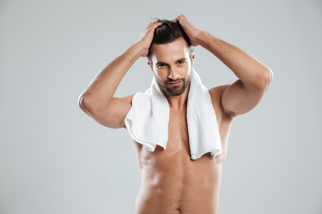 Young man posing with towel