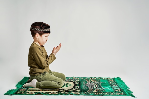 A young man prepares to make his prayers in the month of ramadan