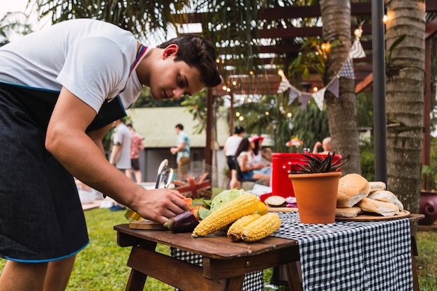 The young man prepares the vegetables