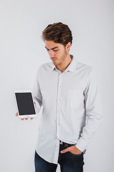 Young man psing with tablet