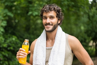 Young man ready to drink after sport
