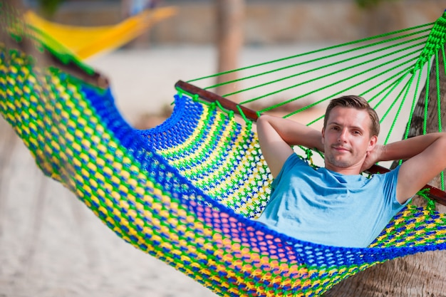Young man relax in hammock