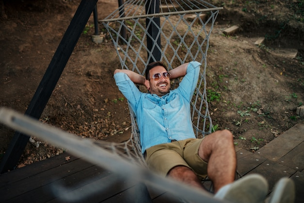 Young man relaxing in a hammock.