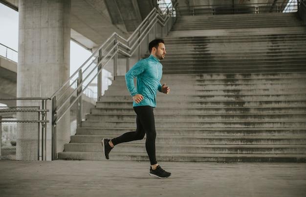 Young man running in urban enviroment
