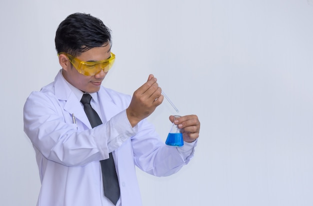 Young man scientist in chemistry lab