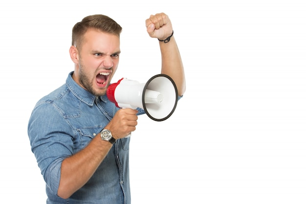 Young man scream with a megaphone