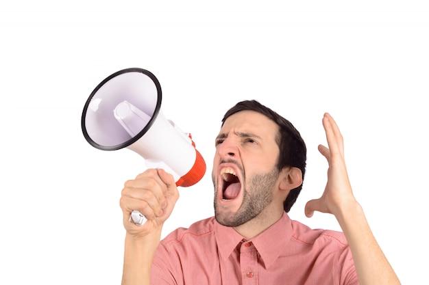 Молодой человек кричал на мегафон.