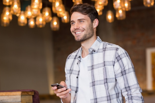 Young man sending a text