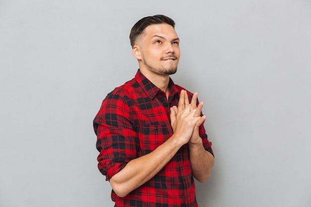 Young man in shirt posing in studio