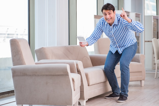 Young man shopping in furniture store