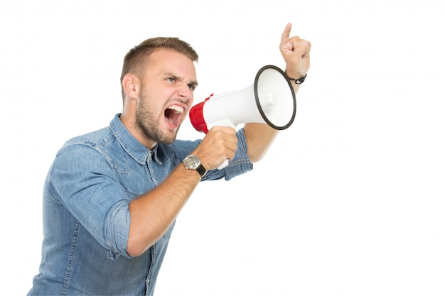 Young man shouting through megaphone, isolated