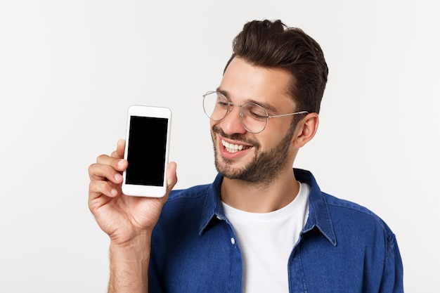 Young man showing his brand new smart phone isolated on white.