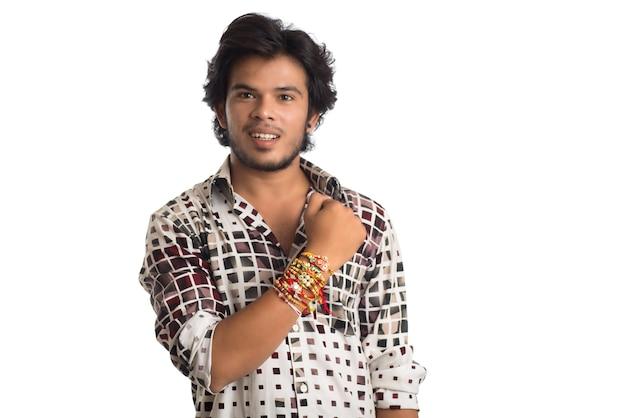 Young man showing rakhi on his hand on an occasion of raksha bandhan festival.