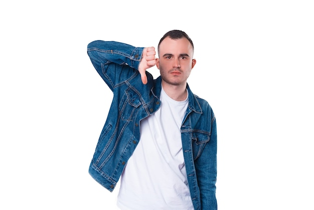 Young man showing thumb down or dislike sign
