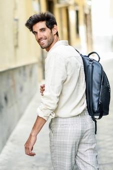 Young man sightseeing enjoying the streets of granada