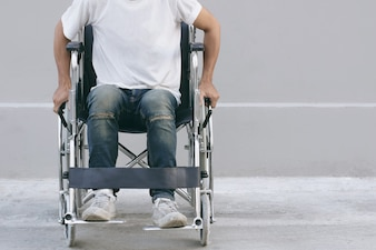 Young man sitting in a wheelchair.selective focus