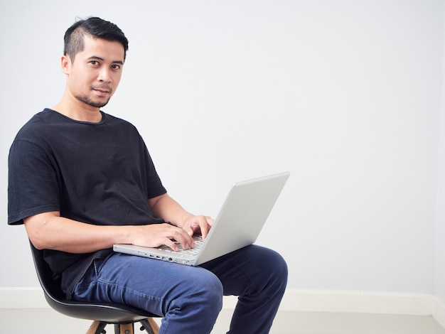 Young man sitting work with laptop