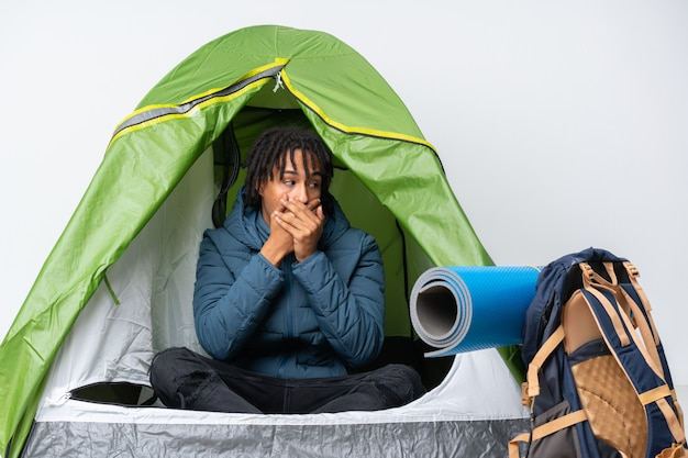 Young man sleepeng in a camping over isolated wall