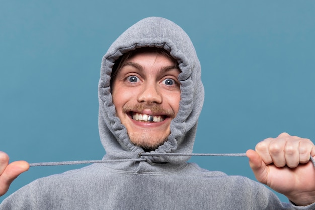 Young man smiling while having a silver tooth