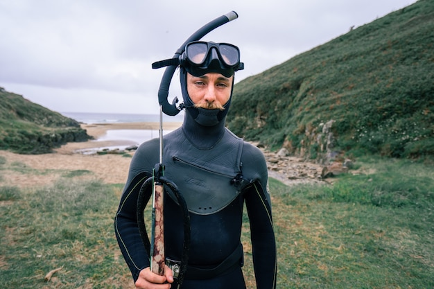 Young man in special diving clothes and glasses