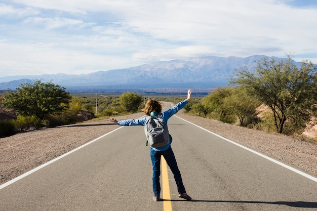 Young man standing on the highway