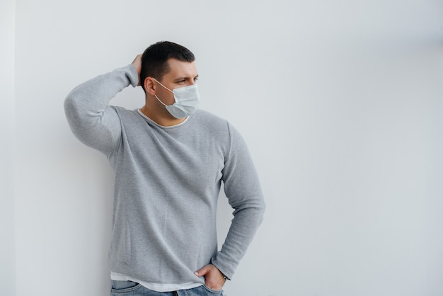 A young man stands wearing a mask during a quarantine