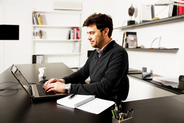 Young man start up over bookshelf background