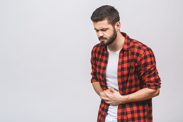 Young man suffering from pain against white background.