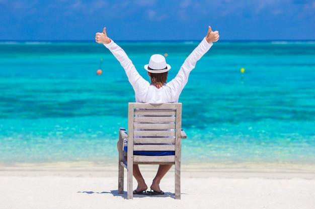 Young man at summer vacation on tropical beach