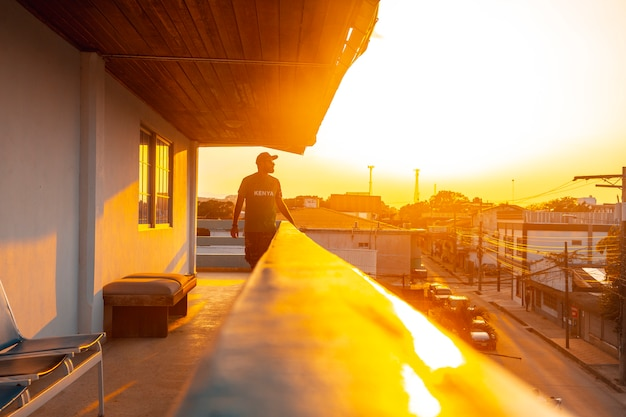 A young man in a sunset from the city
