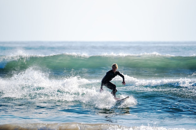 Young man surfing the waves