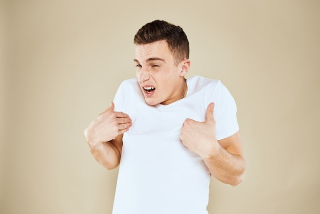 Young man in a t-shirt, handsome guy model, different emotions