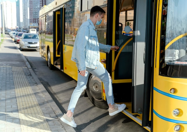 Young man taking the city bus