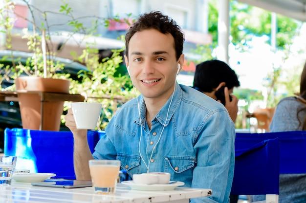 Young man taking a coffee break